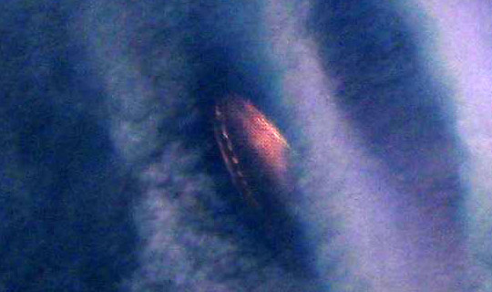 "UFO photo from the CEFAA files taken by a family in the El Yeso reservoir in Cajón del Maipo, near Santiago, on Feb. 14, 2010, considered ""stealthy"" because it wasn't seen by the witnesses. Conclusion: Open case, pending. (Image credit: CEFAA)"