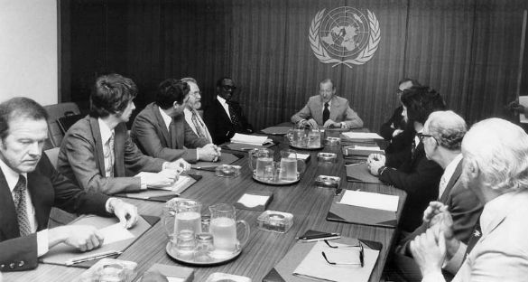 Meeting at the UN on UFOs. Clockwise from left: astronaut Gordon Cooper, astronomer Jacques Vallee, astronomer/astrophysicist Claude Poher, astronomer J. Allen Hynek, Grenada Prime Minister Sir Eric Gairy, UN Secretary-General Kurt Waldheim, Morton Gleisner of the Special Political Committee, Lee Speigel, researcher Len Stringfield, and University of Colorado psychologist David Saunders (Credit: Lee Speigel)
