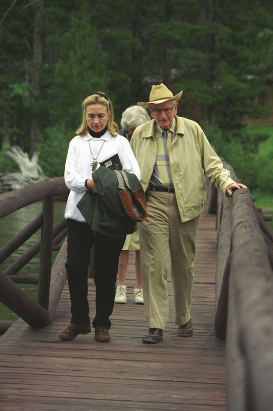 Hillary Clinton and Laurance Rockefeller walking at his Wyoming Ranch (image credit: Clinton Library)