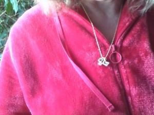 Witness' cross necklace wrapped around itself. (Credit: MUFON)