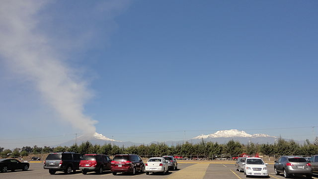Popocatépetl seen from a parking lot at Hermanos Serdán International Airport. (Credit: Danielllerandi/Wikimedia Commons)