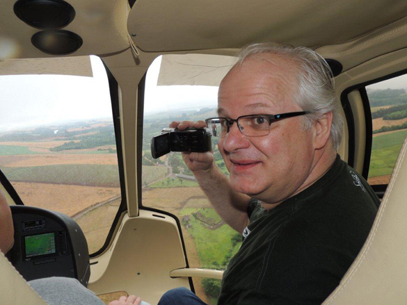 A.J. Gevaerd in a helicopter filming the crop circles. (Credit: Brazilian UFO Magazine)