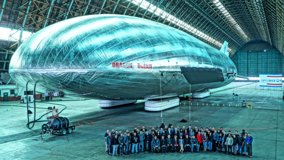 Worldwide Aeros Corp. employees pose with their massive aircraft. It took 4 years to build. (Credit: Worldwide Aeros Corp.)