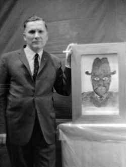 Albert Bender with a drawing of one of the Men in Black he encountered.