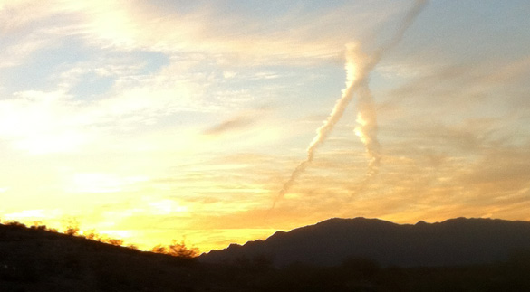 Contrail over the Arizona desert. (Credit: Alejandro Rojas)