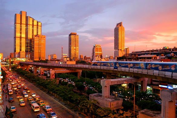 A spectacular sunset in Bangkok, showing the skytrain and modern skyline down Thanon Naradhiwas Rajanagarindra, taken from the corner of Thanon Silom, with the Empire Tower and the Chong Nonsi BTS Station at the left side. (Credit: Wikimedia Commons/Diliff)