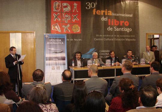 The launching of the book at the Santiago Book Fair; seated on the table (from right to left): Capt. Rodrigo Bravo, Gen. Ricardo Bermúdez, director of CEFAA, Juan Castillo. (image credit: Mario Valdes)
