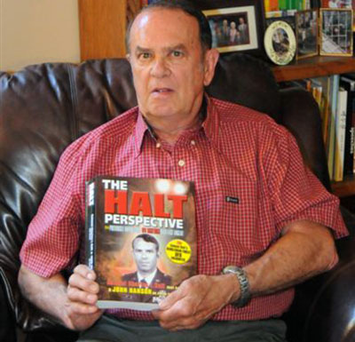 Colonel Charles Halt with the book. (Credit: John Hanson)