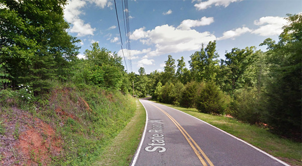 The North Carolina witness was driving along this stretch of Montford Cove Road north of Union Mills when an object the 'size of a large storage shed' moved toward ground level. (Credit: Google)