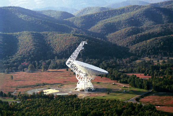 The Robert C. Byrd Green Bank Radio Telescope (GBT) focuses 2.3 acres of radio light. It is 485ft tall, nearly as tall as the nearby mountains and much taller than pine trees in the national forest. The telescope is in a valley of the Allegheny mountains to shield the observations from radio interference. (Credit: National Radio Astronomy Observatory)