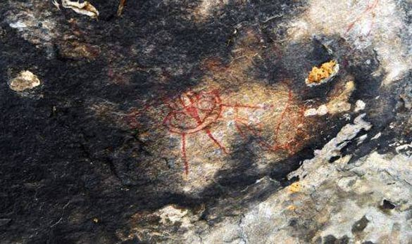 A rock painting that looks similar to a UFO with three legs. (Credit: Amit Bhardwaj/The Times of India)