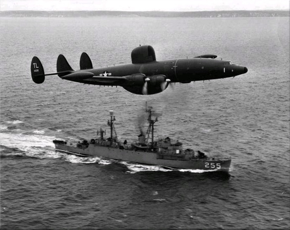 An Atlantic barrier U.S. Navy Lockheed WV-2 Warning Star overflies USS Sellstrom off Newfoundland in 1957. (Credit: Mahlon K. Miller/U.S. Navy)