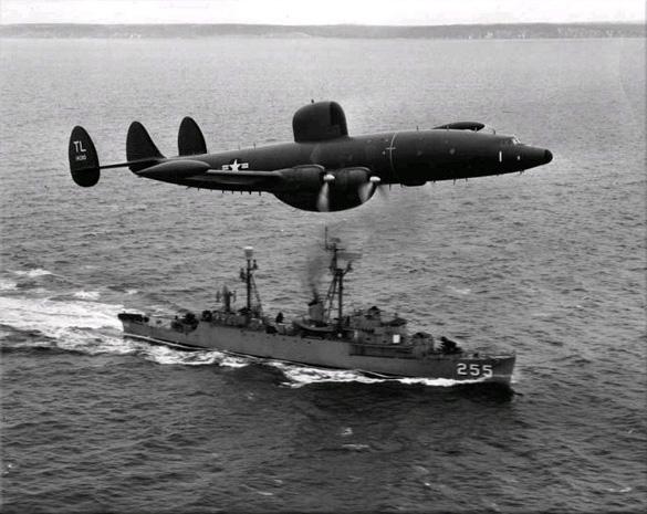 An Atlantic barrier U.S. Navy Lockheed WV-2 Warning Star overflies USS Sellstrom off Newfoundland in 1957. (Credit: Mahlon K. Miller/U.S. Navy)