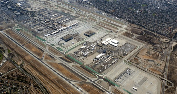 The witness was aboard an airliner at 5:30 p.m. on October 7, 2014, descending into Los Angeles, when a disc-shaped UFO was spotted just three feet from the wing. Pictured: Aerial view of Los Angeles International Airport. (Credit:  Wikimedia Commons)
