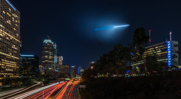 A Trident missile the Navy tested off Los Angeles Saturday night is shown from the Fourth Street bridge over 110 Freeway in Los Angeles. Photographer Preston Newman was on a photo shoot at the time. (Credit: Preston Newman Photography, on Instagram at @Newman_Photos/The San Diego Union-Tribune)