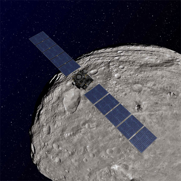 Artist's concept showing Dawn orbiting the giant asteroid Vesta. (Credit: NASA/JPL-Caltech)