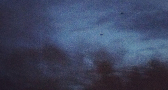 Black disk UFOs photographed in Rhode Island