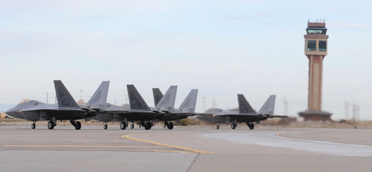 F-22 Raptors lined up on the airfield at Holloman AFB (image credit: USAF)