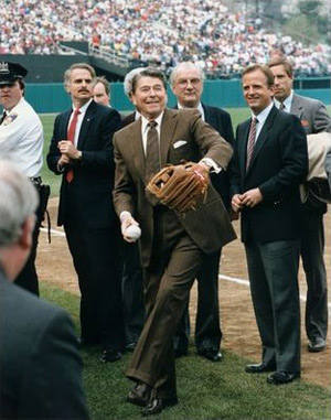 Reagan throws outthe openning pitch at a Chicago Cubs baseball game. Uberroth is in front to his left. (image credit: Reagan Library)