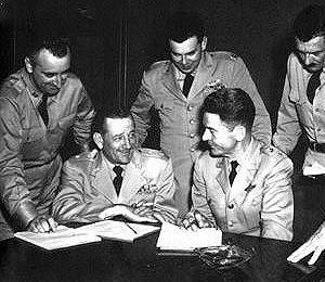 Edward Ruppelt (standing center) at July 29, 1952 Pentagon UFO press conference. Also pictured, Major Generals Roger Ramey (seated left), USAF operations chief, and John A. Samford (seated right), USAF director of intelligence. (image credit: Wikipedia)