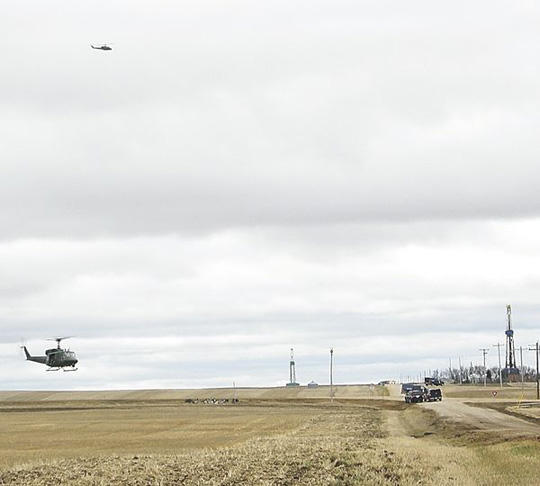 Helicopters circle as Sauder is captured. (image credit: Minot Daily News)