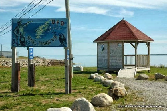 Gazebo and sign outside of the Shag Harbour UFO Incident museum. (Credit: DiscoverShelburneCounty.com)