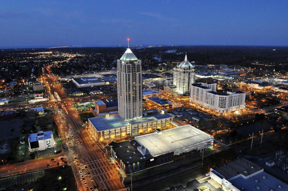 Picture of the Virginia Beach Town Center at night. The Westin Hotel building can been seen in the center. It is the largest building in Virginia. (Credit: UniqueHomes.com)