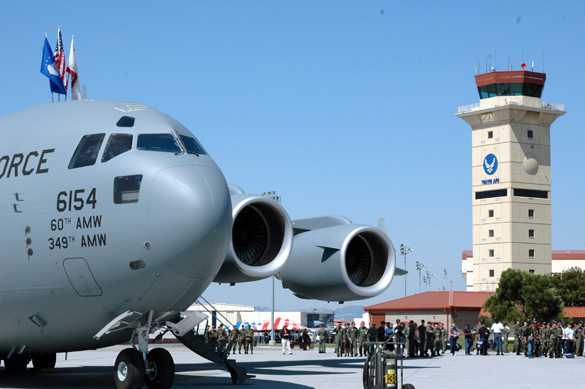 The Travis Air Force Base control tower behind a C-17. (Credit: U.S. Air Force/Staff Sgt. Matt McGovern)