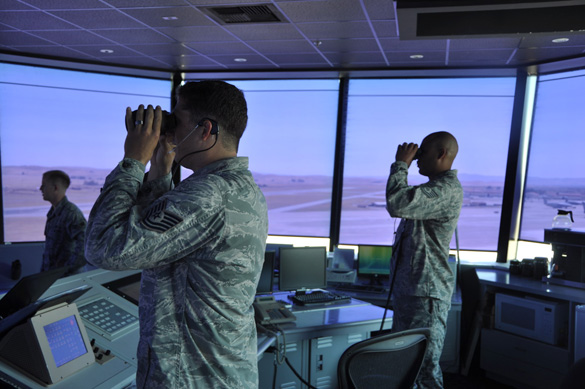 Two air traffic controllers in the control tower at Travis Air Force Base. (Credit: U.S. Air Force/ Staff. Sgt. Patrick Harrower)
