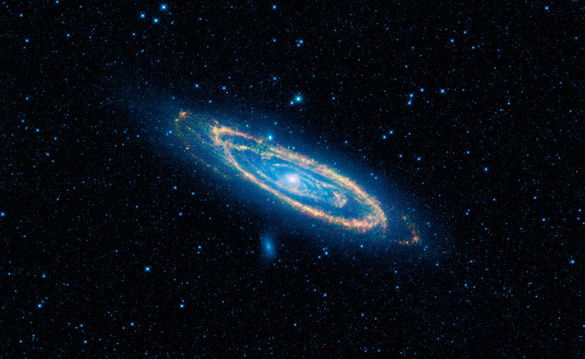A false-color image of the mid-infrared emission from the Great Galaxy in Andromeda, as seen by Nasa's WISE space telescope.  The orange color represents emission from the heat of stars forming in the galaxy's spiral arms. The G-HAT team used images such as these to search 100,000 nearby galaxies for unusually large amounts of this mid-infrared emission that might arise from alien civilizations. (Credit: NASA/JPL-Caltech/WISE Team)