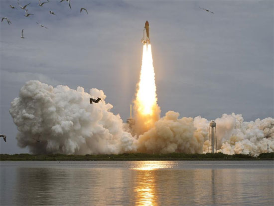 Space shuttle Atlantis blasting off for the final time (credit: NASA/Bill Ingalls)