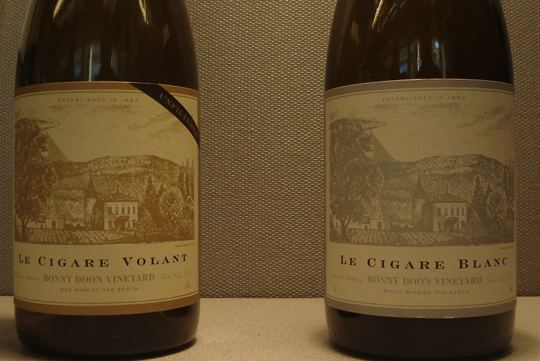 Le Cigare Volant and Le Cigar Blanc bottles (empty).