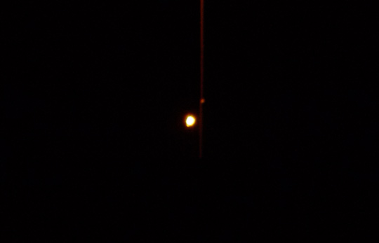 Picture of flare behind light pole from May 3, 2011. (image credit: Alejandro Rojas)