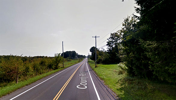 The witness was driving along Elmer Hill Road in Rome, NY, pictured, when he first thought an airplane was flying nearby at the treetop level. (Credit: Google)