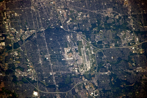 The witness saw a pale green triangle UFO crossing the sky. Pictured: Columbus International Airport seen from the International Space Station. (Credit: Wikimedia Commons)