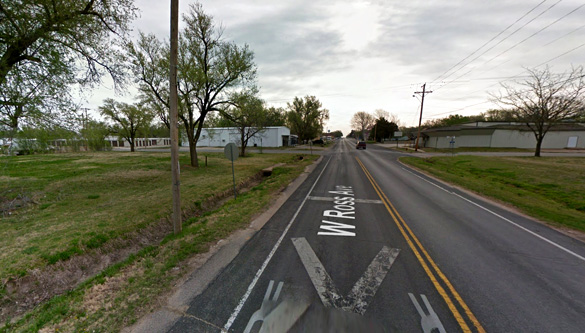 The witness encountered a disc UFO hovering over power lines. Pictured: Facing east in Clearwater, Kansas. (Credit: Google Maps)