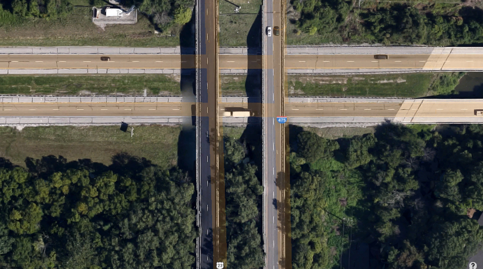 As the object moved away, the witness described the back of the object as having a rectangular panel of solid, bright, red lights made up of 6 to 8 smaller panels butted together. Pictured: Intersection of Route 475 and the Ohio Turnpike. (Credit: Google)