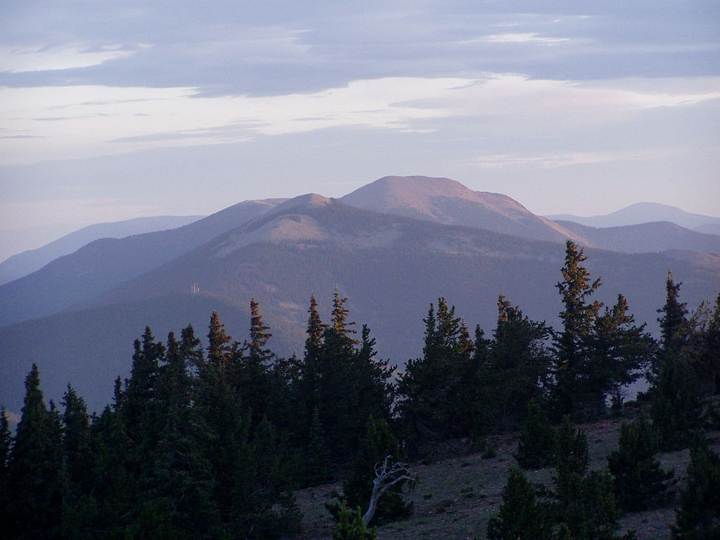 The witness described the object as a round, flat object, about the diameter of a car tire. Pictured: Mount Baldy, from the peak of Mount Phillips. (Credit: Wikimedia Commons)