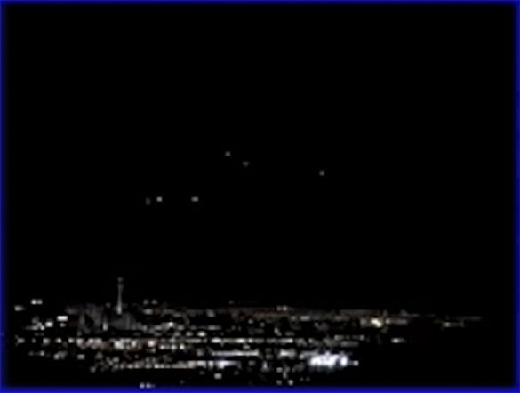 Eventually six lights appeared to hover in the sky. Pictured: Still image cropped and enlarged from the witness video. (Credit: MUFON)