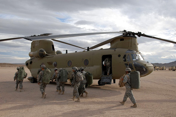 The helicopter appeared to be escorting the UFO. Pictured: Soldiers prepare to board a CH-47F at the National Training Center, Fort Irwin, California. (Credit: Wikimedia Commons)