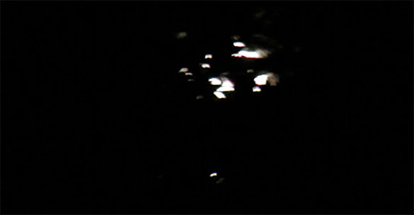 The object appeared to be larger than a basketball if held at arm's length. Pictured: Cropped portion of a video frame from the witness video. (Credit: MUFON)
