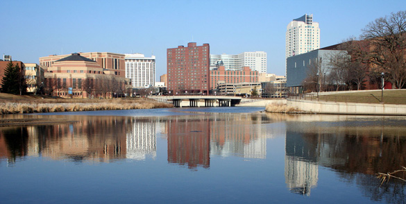 Downtown Rochester reflected in the Zumbro River. (Credit: Wikimedia Commons)