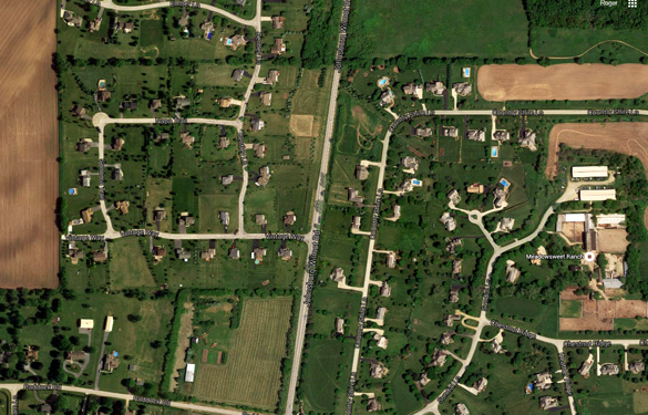 The witness was southbound along Wilmot Road in Spring Grove, IL, when the low flying triangle UFO was seen. Pictured: A portion of Wilmot Road in Spring Grove, IL. (Credit: MUFON)