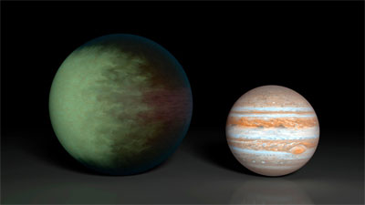 Artist's rendition of Kepler-7b (left) with Jupiter for comparison. (Credit: NASA/JPL-Caltech/MIT)