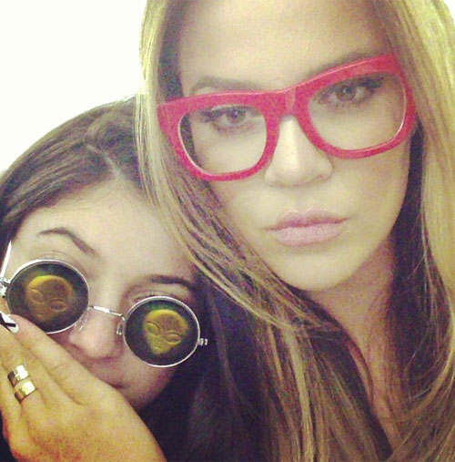 Kylie Jenner wearing alien sunglasses, with Khloe Kardashian. (Credit: Instagram/khloehardashian)