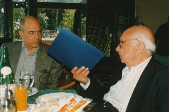 Maurizio Baita (left) receiving documents from  Colonel Corso (right).