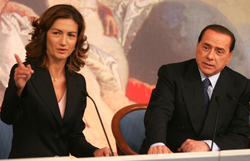 Left: Mariastella Gelmini, Italian Minister of Education Right: Silvio Berlusconi, Italian Prime Minister