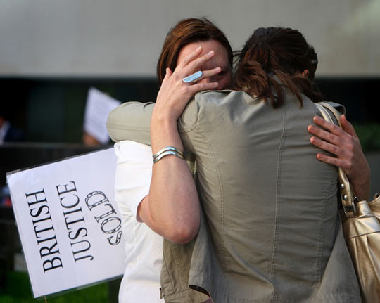 Lucy Clarke, McKinnon's girlfriend, is comforted at a protest. (credit: Cate Gillon/Getty Images Europe)