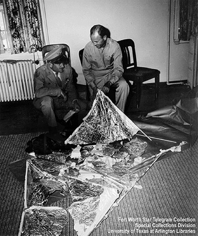 General Roger Ramey (left) with Colonel Thomas Dubois looking the weather balloon Ramey claimed was mistaken for a flying saucer in Roswell in 1947.