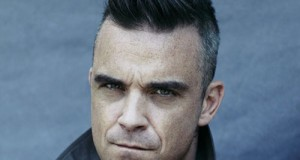 Robbie Williams buying an island to spot UFOs in peace
